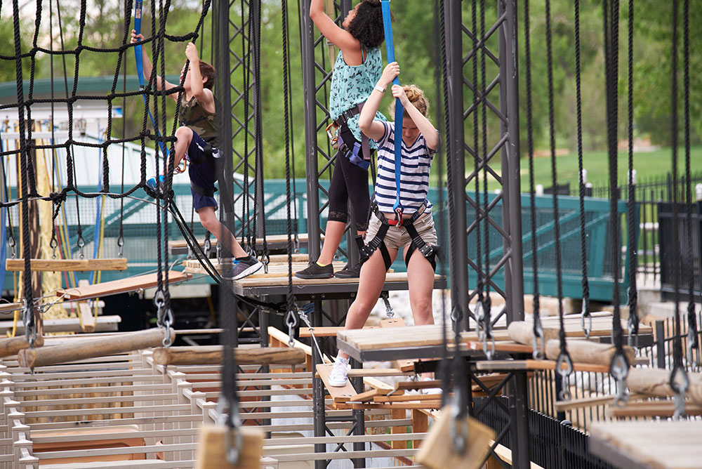 three kids on rope course