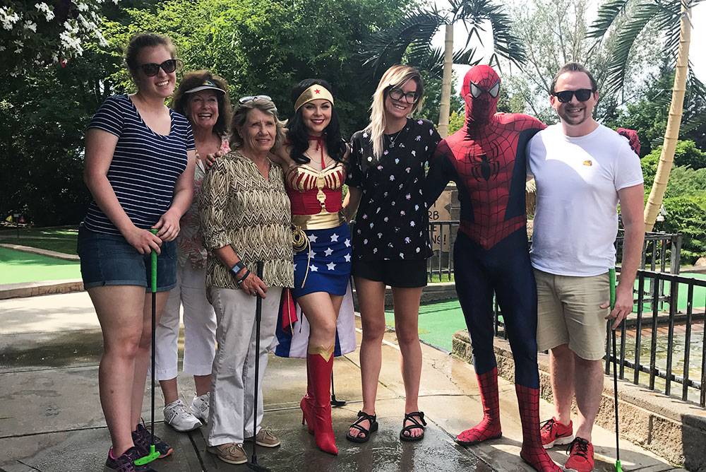 group of 7 people including spiderman and wonder woman